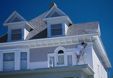 painter painting the exterior of the house
